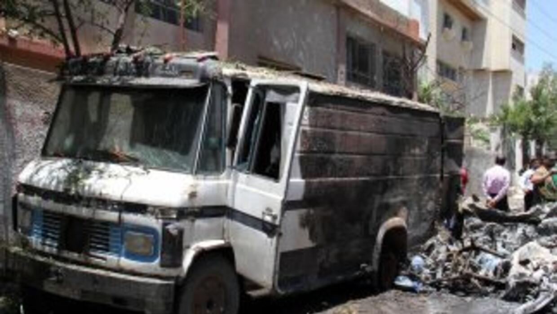 Las fuerzas sirias combatían el viernes con los rebeldes en Damasco en u...