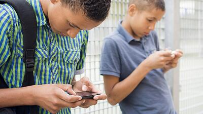 kids and social media on smart phone