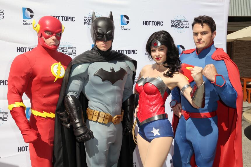LOS ANGELES, CA - APRIL 18: Fans pose dressed as DC Comics Super Heroes...