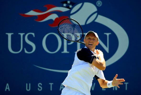 Nikolay Davydenko debutó con una victoria en cinco sets.