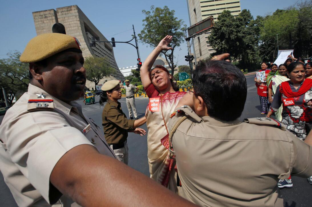 A woman scuffles with police during a rally marking the international Wo...