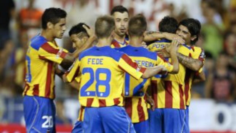 Valencia celebra su triunfo sobre Olympiacos.
