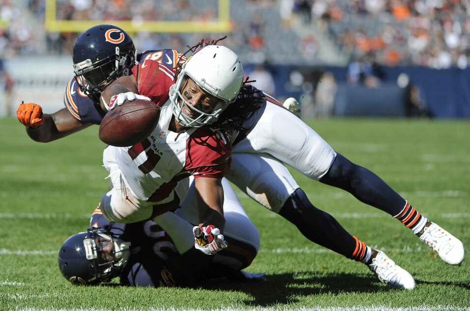 Larry Fitzgerald recibió tres de los cuatro pases de touchdown de Carson...