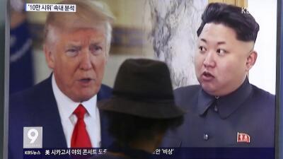 Donald Trump (i) y Kim Jong Un (d), en una imagen de archivo.