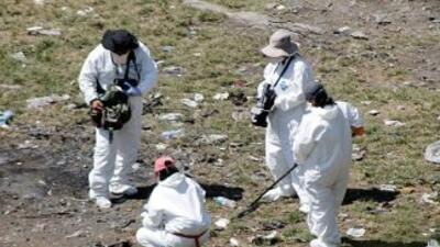 El levantamiento de restos humanos y evidencia en el Basurero de Cocula...