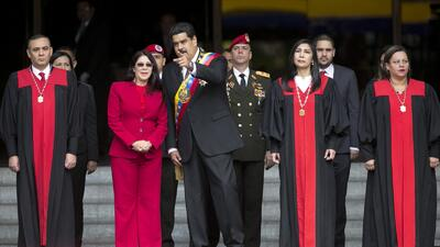 Venezuela's President Nicolas Maduro speaks with first lady Cilia Flores...