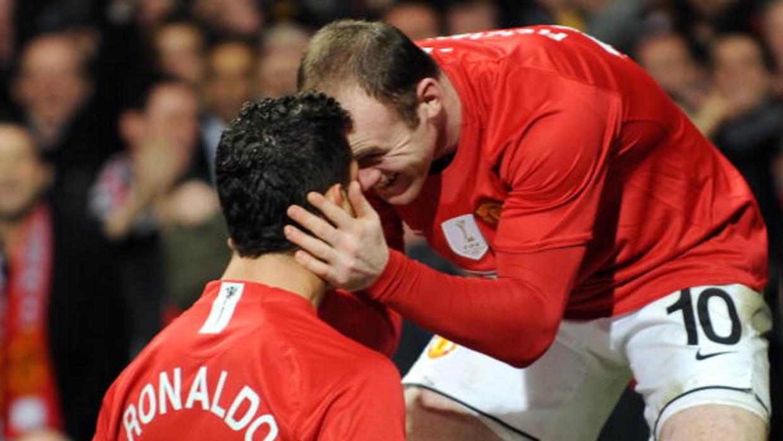 Cristiano Ronaldo y Wayne Rooney celebran un gol con Manchester United