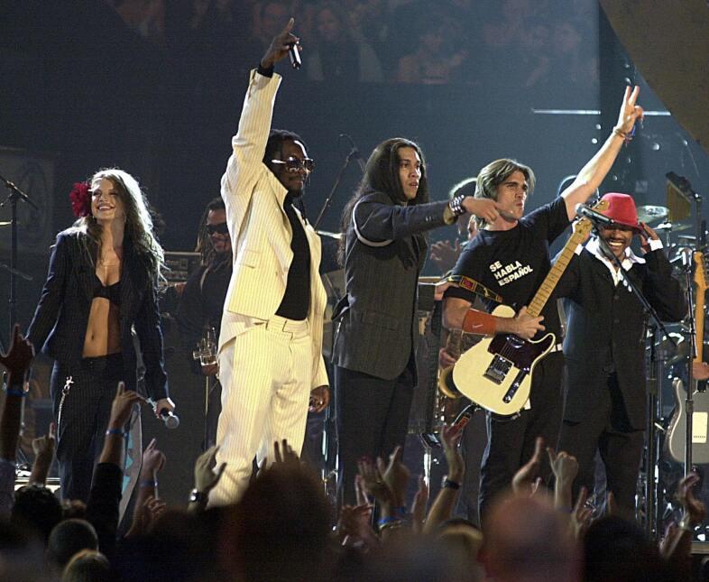 Año: 2003 Juanes y The Black Eyed Peas
