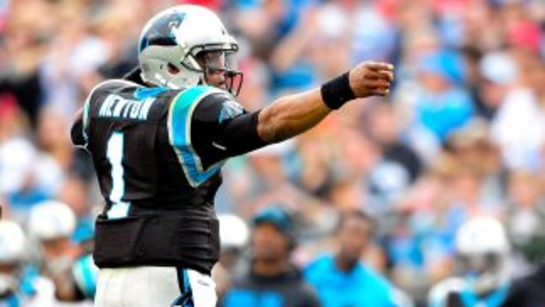 Cam Newton:Ante la pobre defensiva de los Saints y el hecho de que Cam...