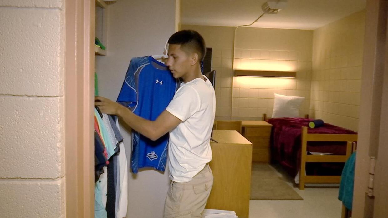 José accommodates his belongings in the dorm, in which he says he feels...