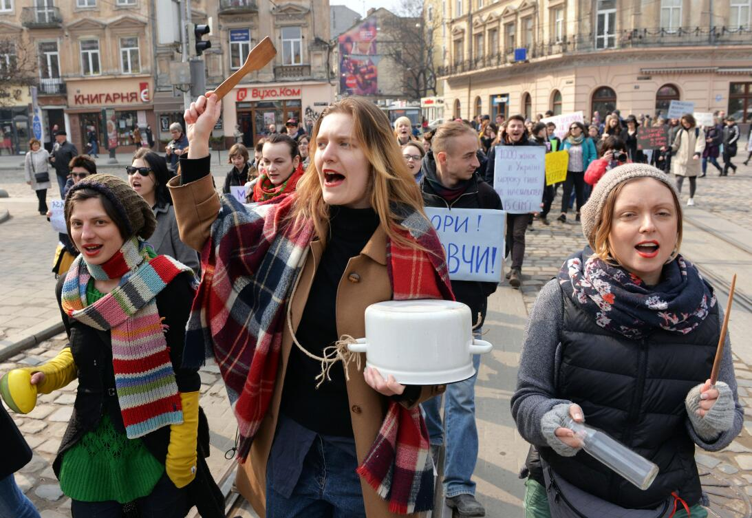 Ukrainian feminist supporters take part in a march marking of the 40th I...