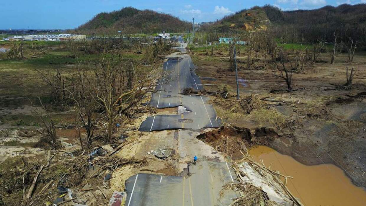 A man cycling on a Toa Alta road, west of San Juan, Puerto Rico, Sept 24...