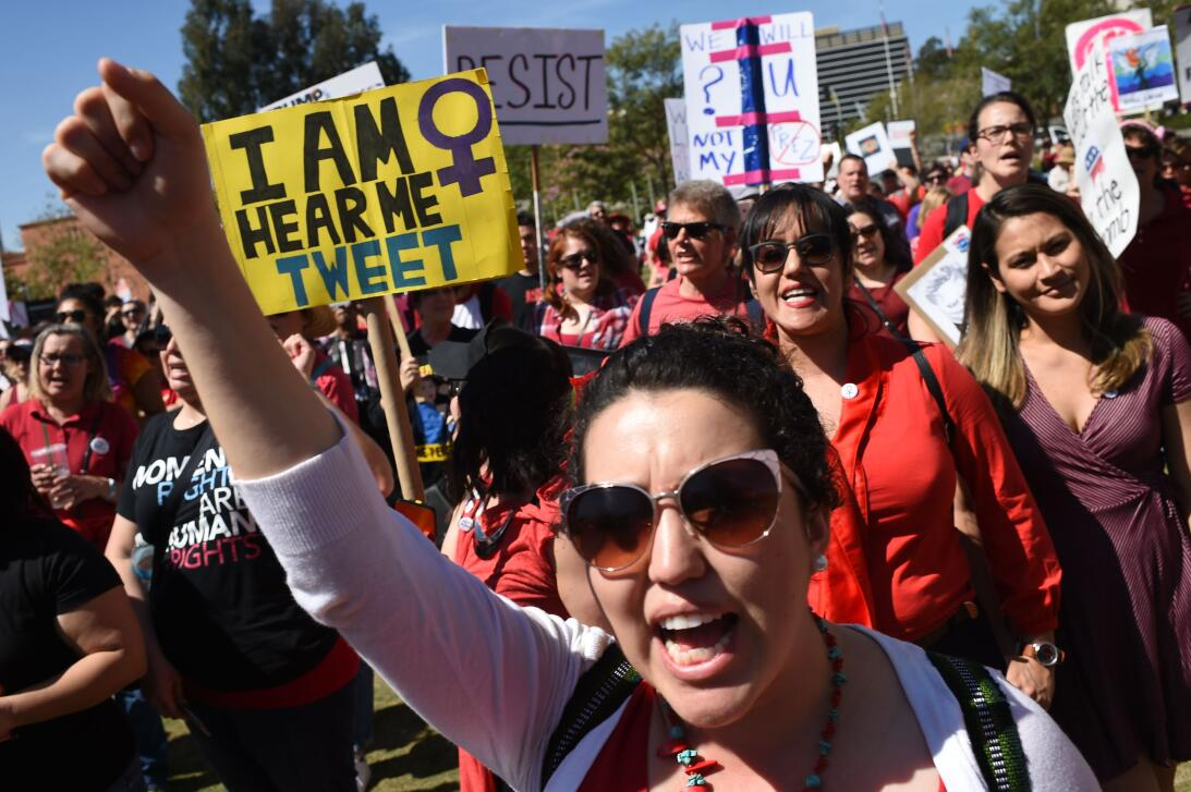 """People attend """"A Day Without a Woman"""" rally honoring Internati..."""