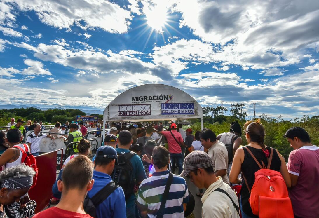 Venezuelan citizens queue to cross the Simon Bolivar international bridg...