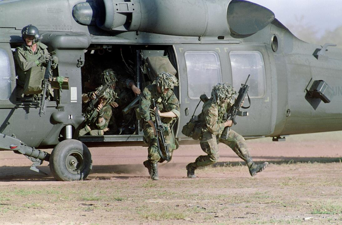 SANTIAGO, PANAMA:  U.S. soldiers run for cover following their arrival a...