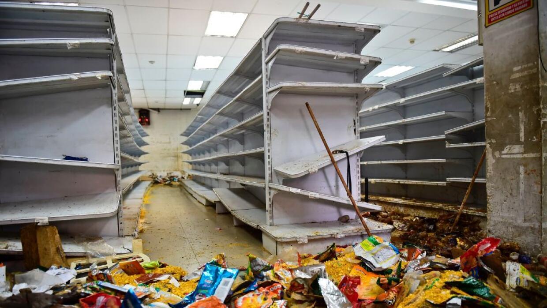Así quedó un supermercado de Caracas tras los saqueos que ocurrieron ent...